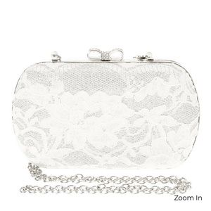 White lace with rhinestone bow closure clutch